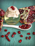 Pomegranate seed oil in bottle Royalty Free Stock Photo