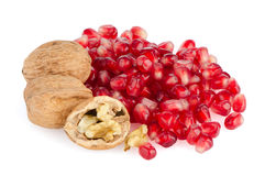 Pomegranate seed pile and nuts Royalty Free Stock Photography