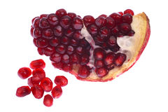 Pomegranate seeds. Grains and some ripe pomegranate on a white background Stock Images