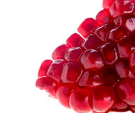Pomegranate seeds. On the white royalty free stock photos