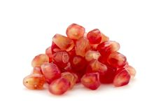 Pomegranate Seeds. Just the inside fruit of a pomegranate (Punica granatum) on white background royalty free stock images
