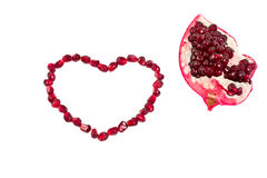 Pomegranate Seeds. Laid out in a heart shape royalty free stock images
