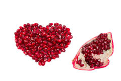 Pomegranate Seeds. Laid out in a heart  shape Stock Photography