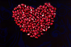 Pomegranate Seeds. Laid out in a heart shape royalty free stock image
