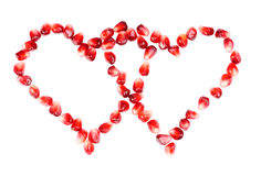 Pomegranate seeds as heart shaped Stock Photo
