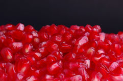 Pomegranate seeds on black Stock Images