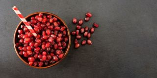 Pomegranate seeds in a bowl on a dark background.  royalty free stock photos