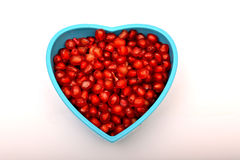 Pomegranate seeds in bowl isolated on white Stock Images