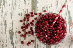 Pomegranate seeds in a bowl on a old wooden background stock photography