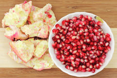 Pomegranate seeds in bowl with pulp Royalty Free Stock Photo