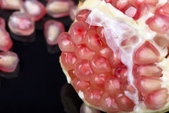Pomegranate. Seeds closeup on the black background Royalty Free Stock Photo
