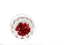 Pomegranate  seeds in crystal glass Stock Photography