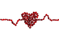 Pomegranate seeds forming cardiogram royalty free stock image