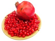 Pomegranate seeds and fruit Royalty Free Stock Photo