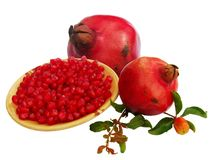 Pomegranate seeds and fruits Royalty Free Stock Photos