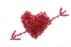 Pomegranate seeds. Heart made from pomegranate seeds Royalty Free Stock Photos