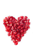 Pomegranate seeds in heart shape isolated Stock Images
