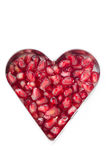 Pomegranate seeds in heart shape isolated Royalty Free Stock Photo
