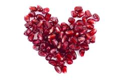 Pomegranate seeds in heart shape isolated Royalty Free Stock Images