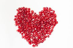 Pomegranate seeds in heart on white background Royalty Free Stock Image