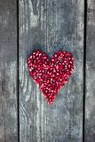 Pomegranate Seeds In Heart Shape Stock Image