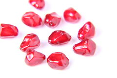 Pomegranate Seeds. In isolated white background stock photo