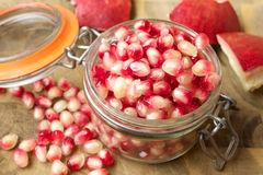 Pomegranate seeds in a jar Royalty Free Stock Photos