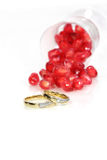 Pomegranate seeds and marriage rings Stock Image