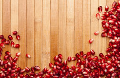 Pomegranate of seeds on the mat. The cleared pomegranate of seeds on the Wooden mat Stock Photos