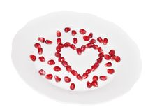 Pomegranate seeds on a plate Stock Images