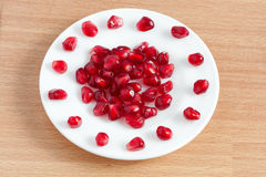 Pomegranate seeds on a plate Royalty Free Stock Photography