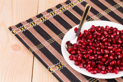 Pomegranate seeds on plate. Royalty Free Stock Photo