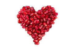 Pomegranate seeds in a shape of a heart Stock Image