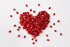 Pomegranate seeds in a shape of a heart Stock Photography