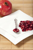 Pomegranate seeds on a spoon Royalty Free Stock Photo