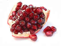 Pomegranate seeds on white Royalty Free Stock Images