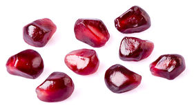 Pomegranate seeds on white. Background stock images