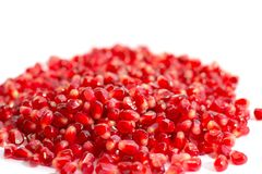 Pomegranate seeds on white background royalty free stock images