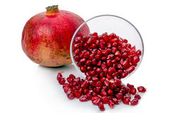 Pomegranate and seeds  on white Royalty Free Stock Image