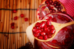 Pomegranate Set. Good healthy by Pomegranate seed on wooden spoon and cool Pomegranate juice set on red Themes tone background. Have some space for write stock photography