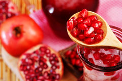 Pomegranate Set. Good healthy by Pomegranate seed on wooden spoon and cool Pomegranate juice set on red Themes tone background. Have some space for write stock image