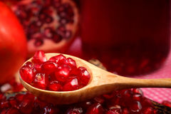 Pomegranate Set. Good healthy by Pomegranate seed on wooden spoon and cool Pomegranate juice set on red Themes tone background. Stock Image
