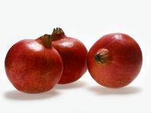 Pomegranate. Several whole pomegranate on a white background Stock Photos