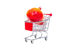 Pomegranate  in shopping cart isolated on white background Stock Images