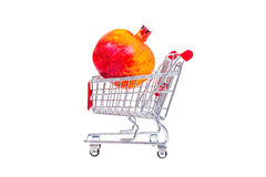 Pomegranate  in shopping cart isolated on white background Stock Photography