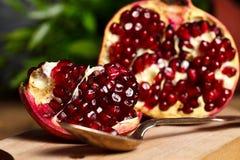 Pomegranate with silver teaspoon Royalty Free Stock Photos