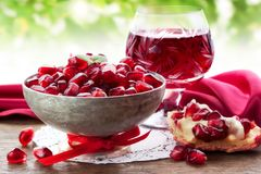 Pomegranate Slice, Grain And Juice Royalty Free Stock Image
