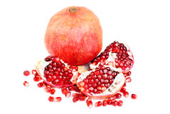 Pomegranate and slice  on white Royalty Free Stock Images