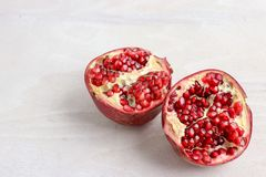 A pomegranate sliced in half royalty free stock photos