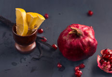 Pomegranate, sliced lemon and vanilla Royalty Free Stock Photos